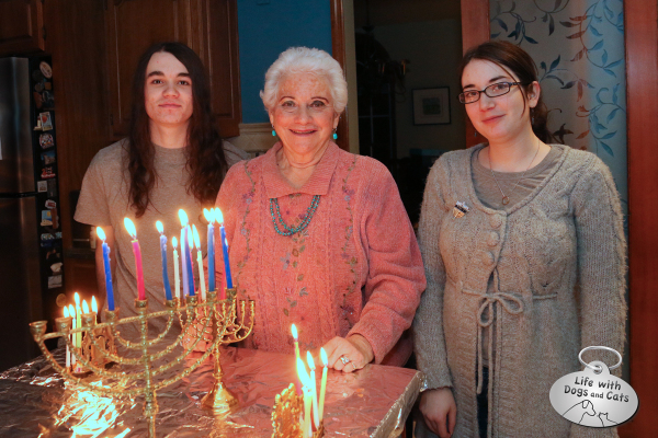 Lighting Hanukkah candles with the family