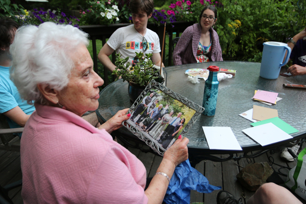 My mom holding one of Corinne's Mothers' Day gifts, a framed photo from her and Luke's wedding.