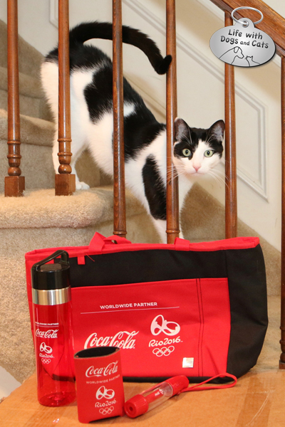 Elsa Clair poses proudly with her official Coke Olympic swag,.