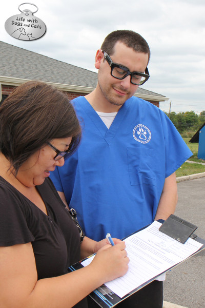 Filling out the paperwork to adopt a dog at the Somerset Regional Animal Shelter.