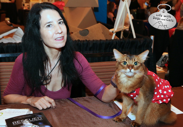 Janiss Garza and Summer cat signing Rescued at the CWA table at BlogPaws
