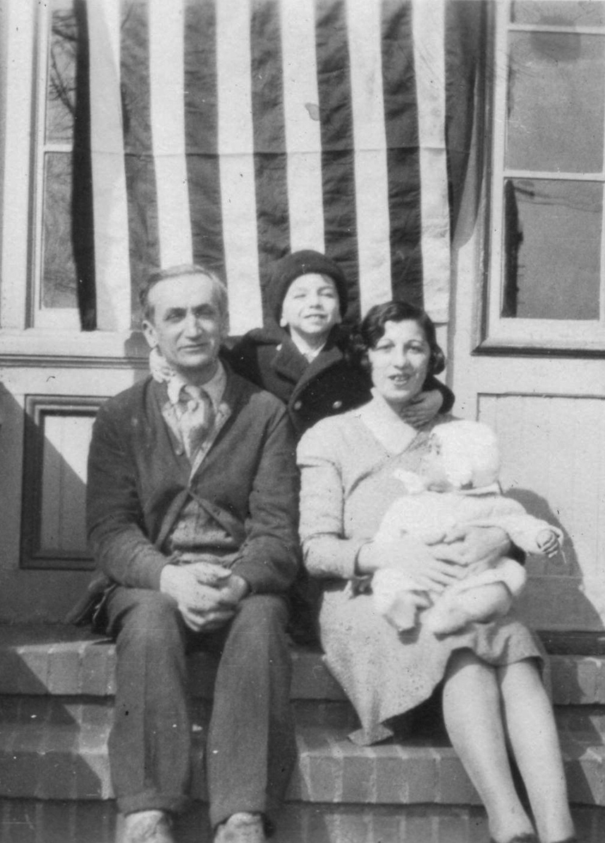 My grandparents, with my dad and uncle, on the porch of the farmhouse.