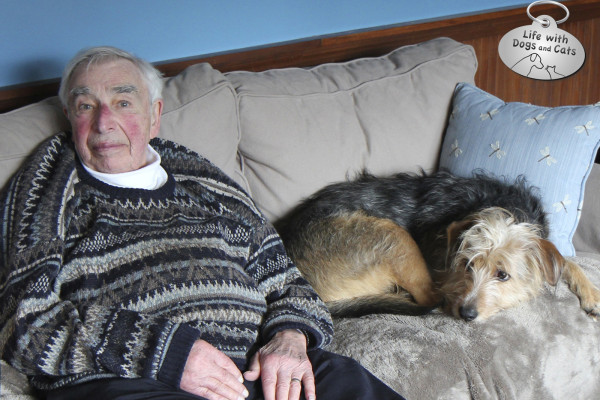 My father sitting next to my dog Tucker, who reminded him of his first dog ever, an AIredale Terrier named Ruby.