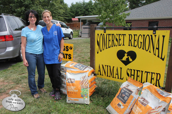 A dozen bags of dog food are donated to the Somerset Regional Animal Shelter