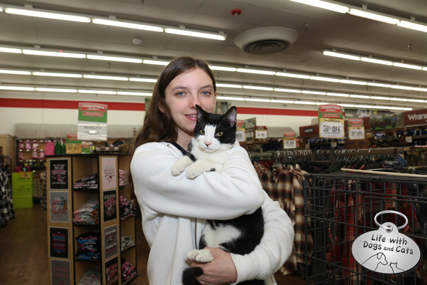 Vicki Kuntz of the Somerset Regional Animal Shelter cuddles Pinnacle, one of the adoptable (and very sweet) cats at the adoption event at Tractor Supply Company.