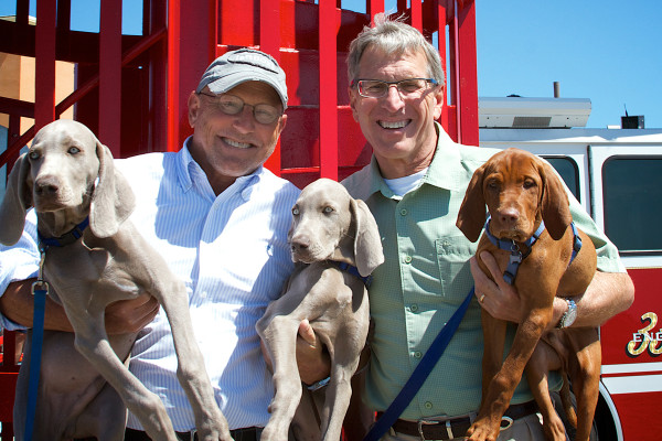 Fire hydrant sculpture unveiled at Wildwood NJ dog beach. Jack and Will Morey pose with their dogs.