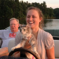 Sophie, a cat with cerebellar hypoplasia, captains a boat on Lake Juliette