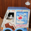 Calvin looks out the window of the ice cream truck cat box