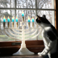 Elsa Clair inspects the menorah in the window.
